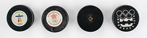 Winter Olympics Group of (4) Hockey Pucks